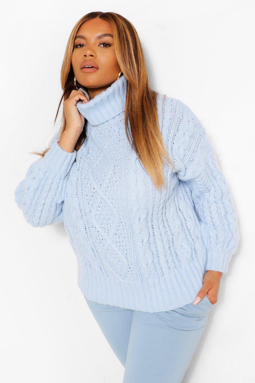 a model wearing the sweater wearing a turtle neck in light blue