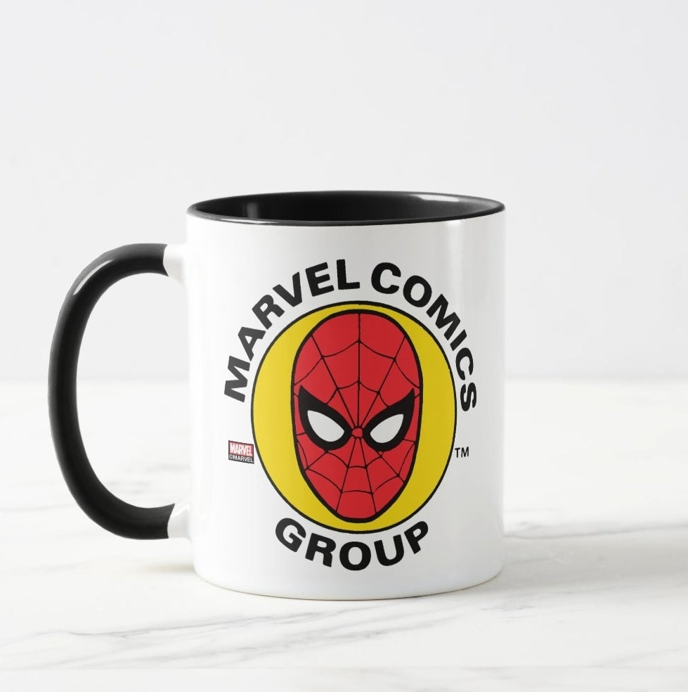 White mug with black handle and interior with Spider-Man face logo