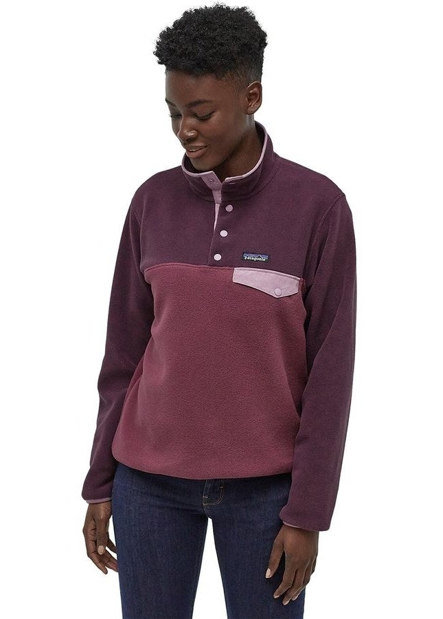 model in three-colored monochromatic maroon fleece with quarter-snap top