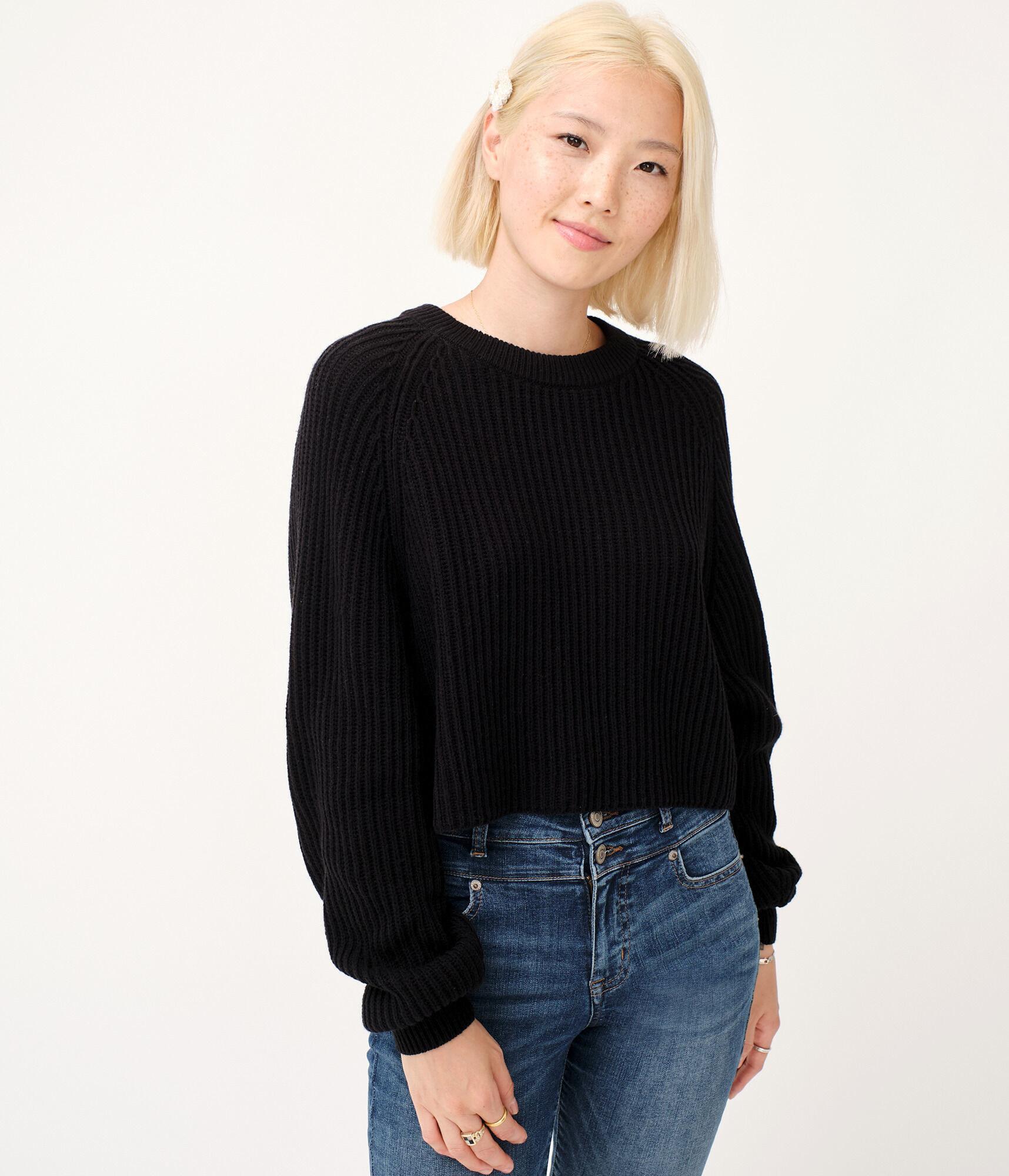 a model in the long sleeve cropped hem sweater in black
