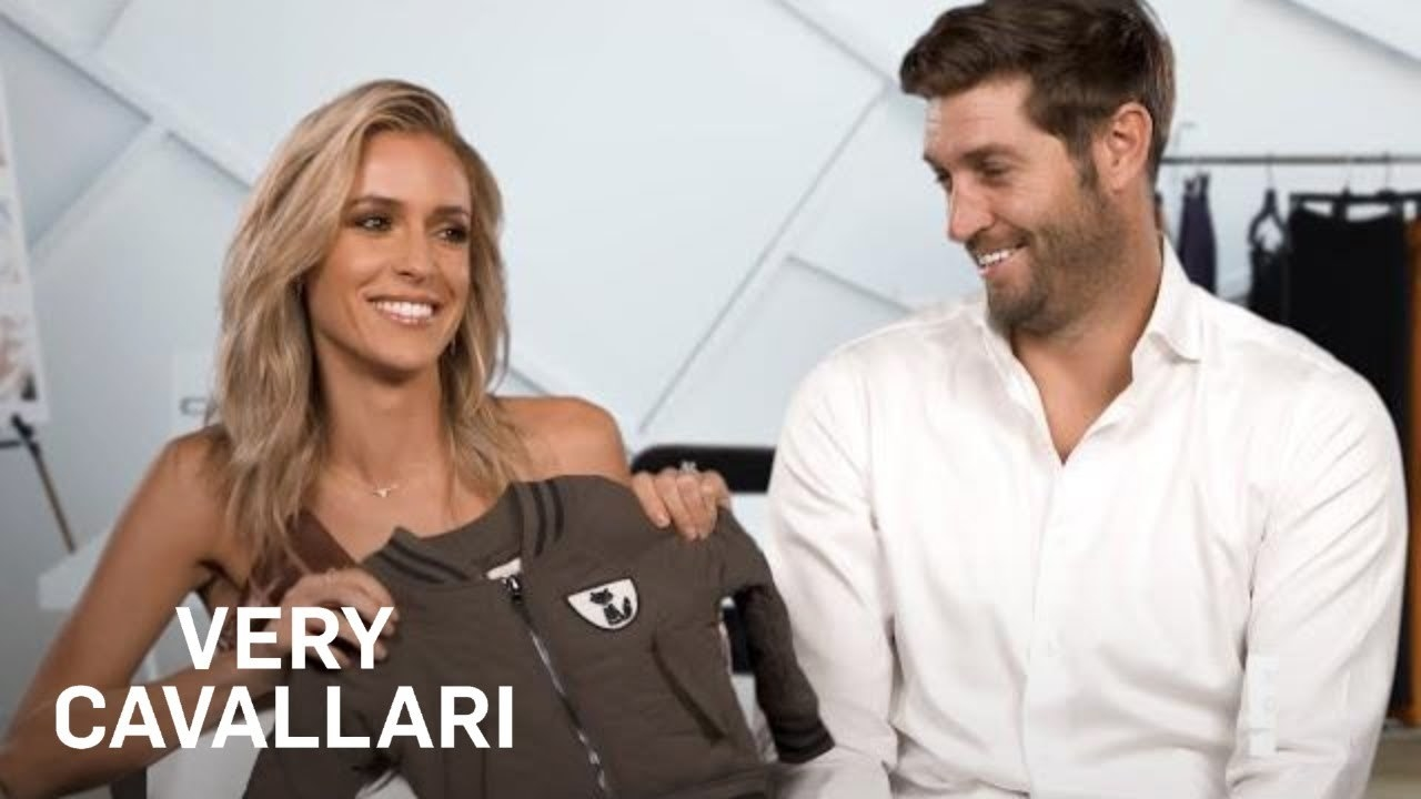 Kristin Cavallari smiles while holding a children's jacket, while Jay smiles at her