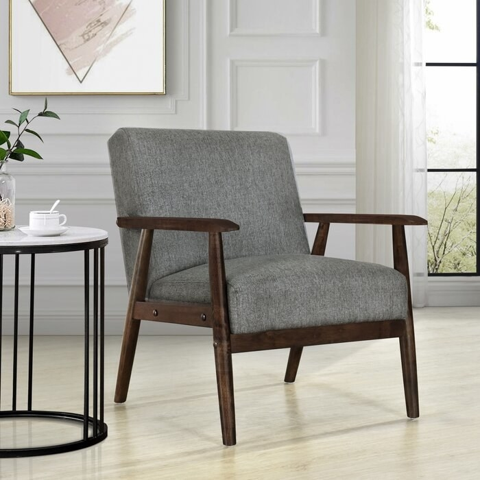 Gray arm chair with wood accents