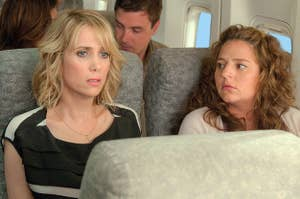 Annie sitting next to the nervous woman on the plane in