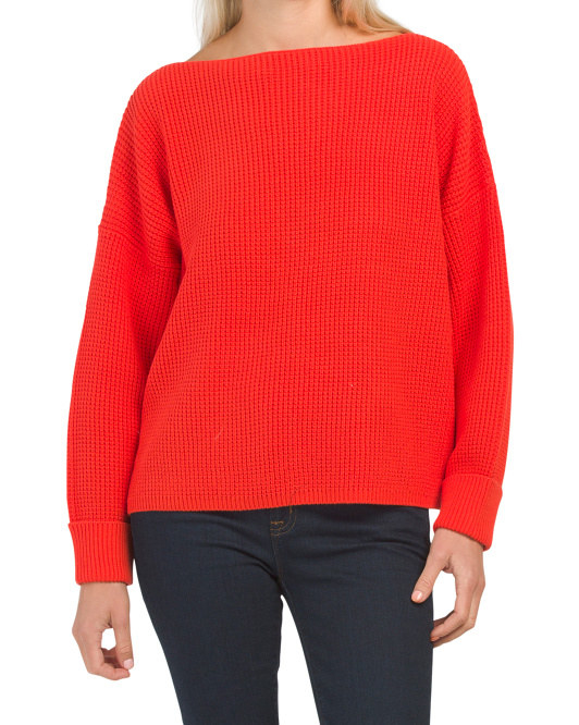 a model in the red sweater