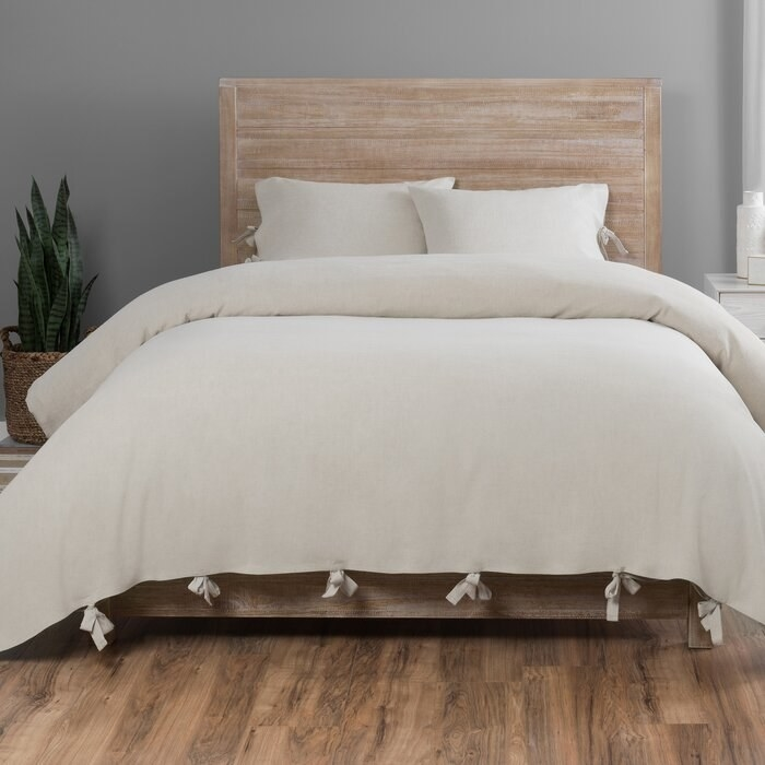 The Natural Legette Duvet Cover Set on a bed