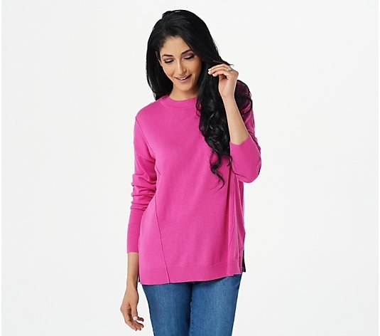 a model in the sweater in bright pink