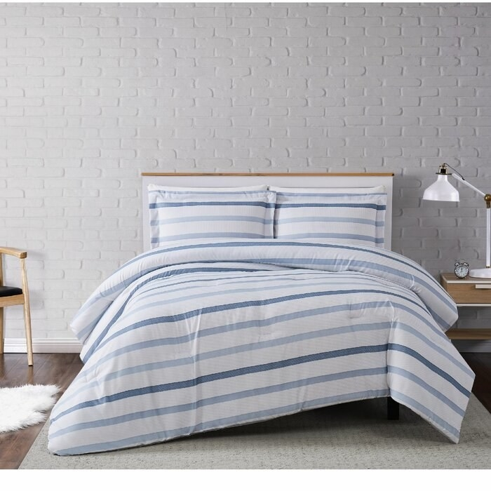 The Bova Soft Waffle Stripe Comforter Set on a bed