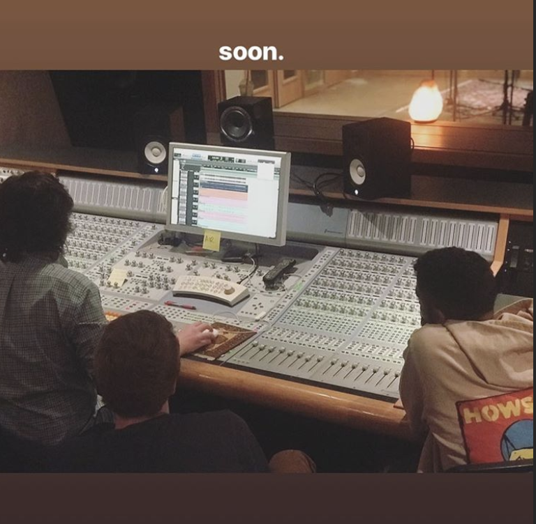 Jharrel in a music studio with producers