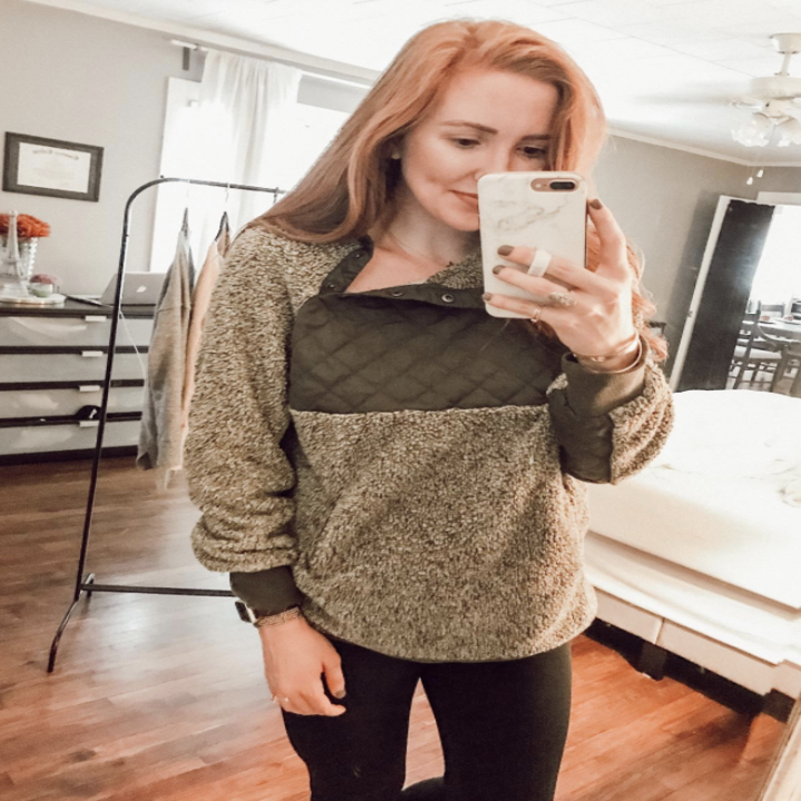 another reviewer in the sweater in brown