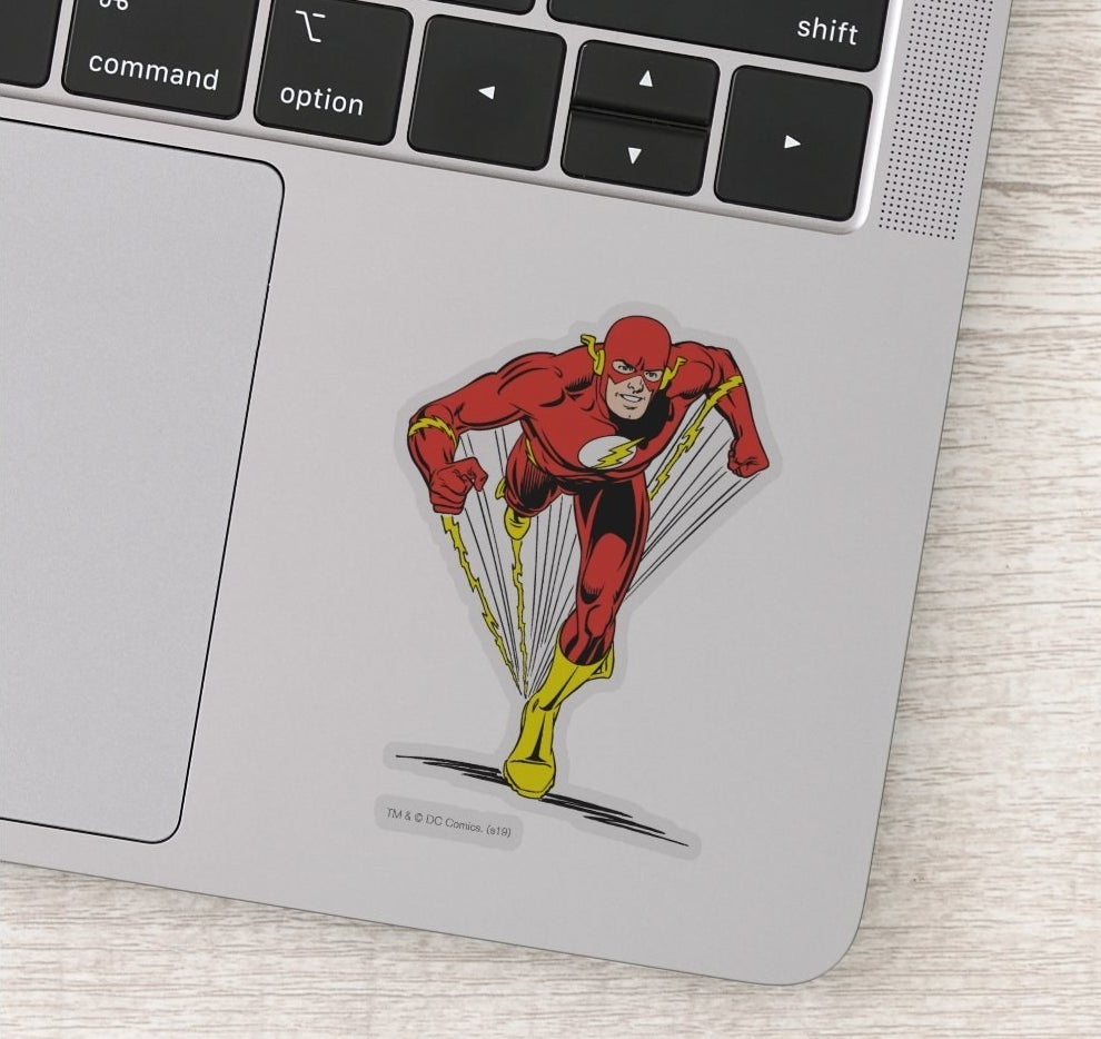Sticker of the Flash in classic red and yellow costume on a laptop