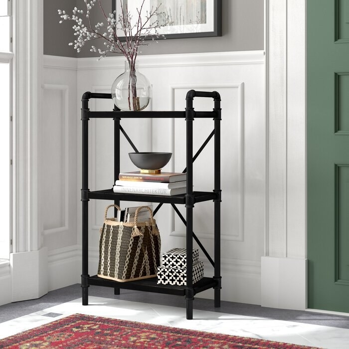 The Luis Etagere Bookcase in an entryway
