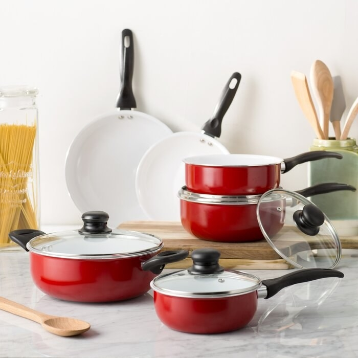 The red 10-Piece Nonstick Ceramic Cookware Set on a kitchen counter