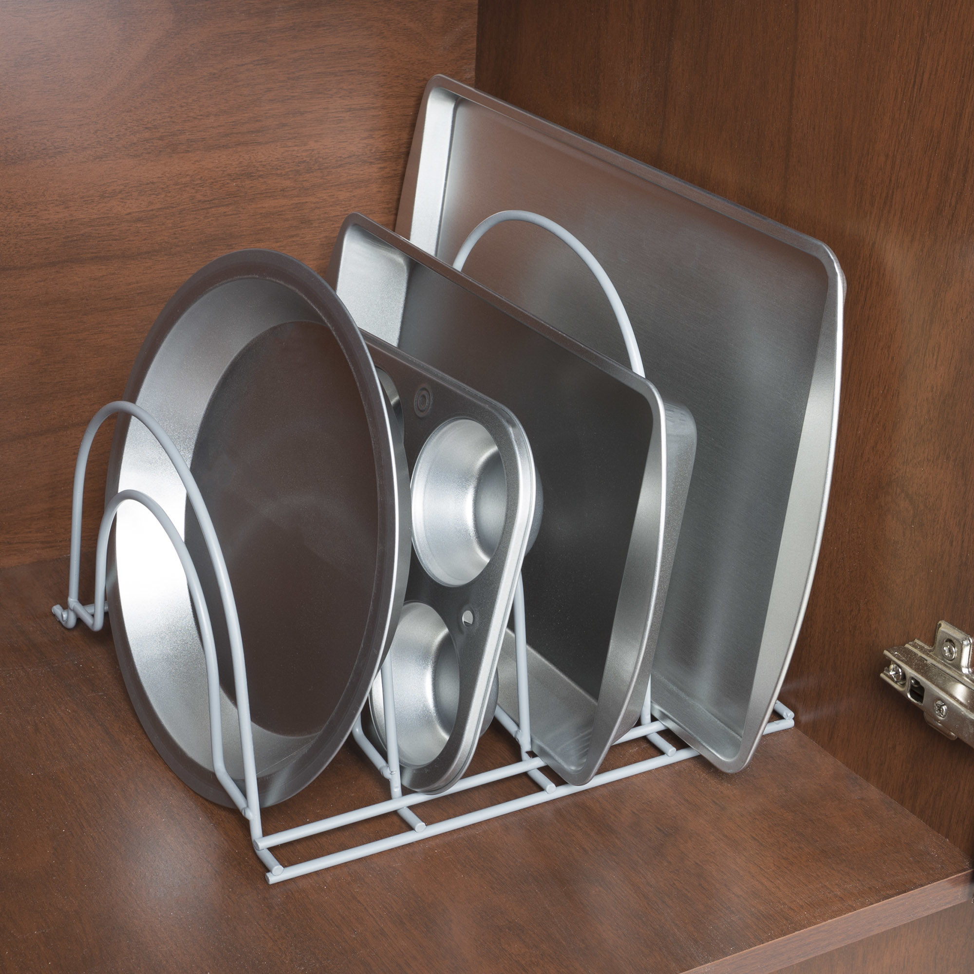 The organizer used in cupboard to hold pots and pans