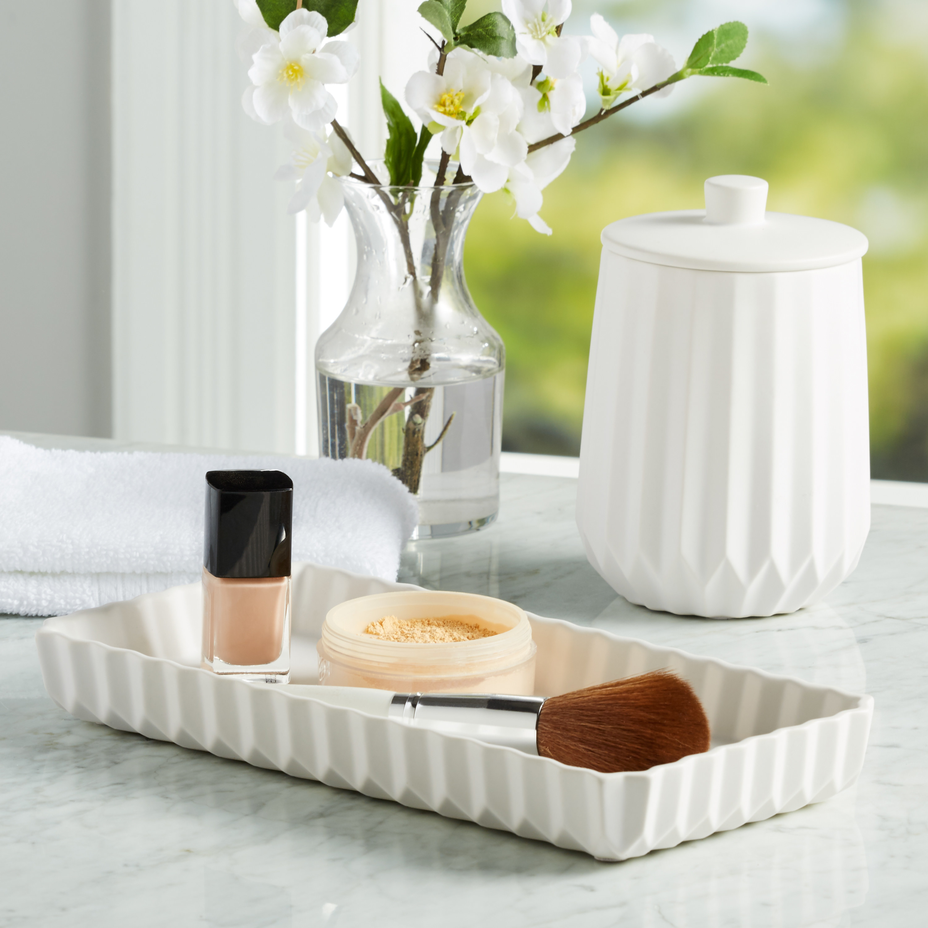 The bath accessory set used on vanity to hold makeup