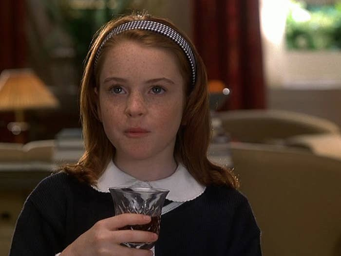 """Lindsay Lohan in """"The Parent Trap"""" tasting a glass of wine."""