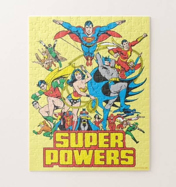A yellow Super Powers puzzle featuring all the classic DC super heroes