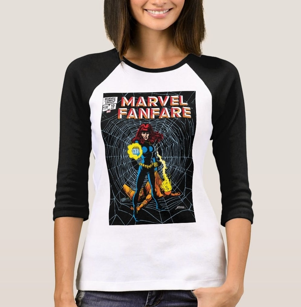 Model wearing a  white raglan T-shirt with black sleeves and a Black Widow cover to Marvel Fanfare