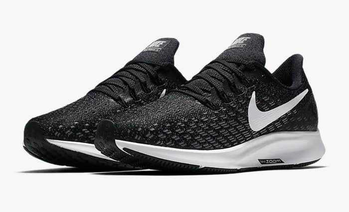 The shoes in black with white soles and a white swish