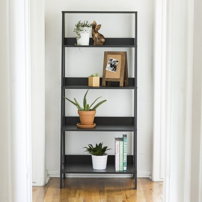 Product photo showing Imogen ladder bookcase in black
