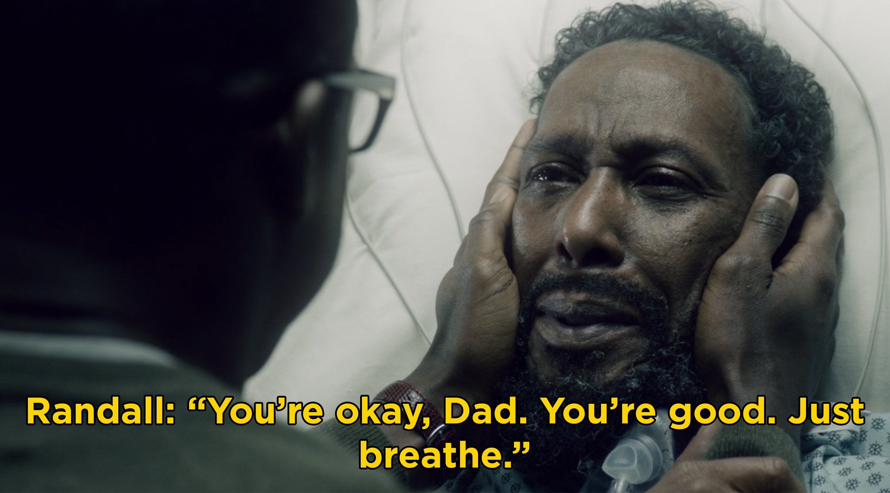 "Randall holding William's face and saying, ""You're okay, Dad. You're good. Just breathe"""