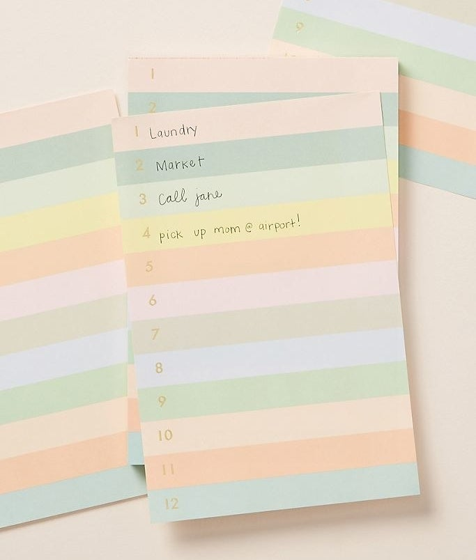 A cute multi-colored pastel notepad featuring numbers 1 to 12 in gold