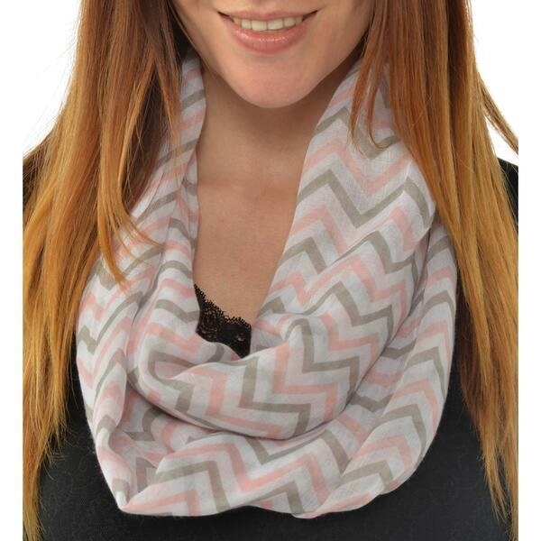 Woman in pink, gray, and white chevron infinity scarf