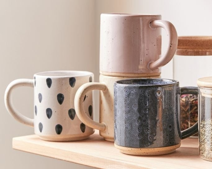 Ceramic mugs with natural boho designs, featuring one perfectly stacked on another