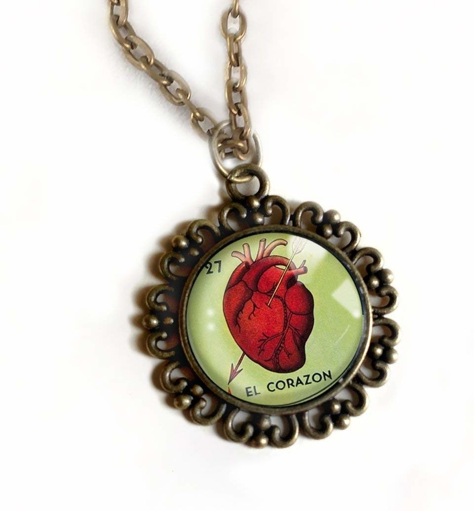 pendant necklace with El Corazon loteria design on it