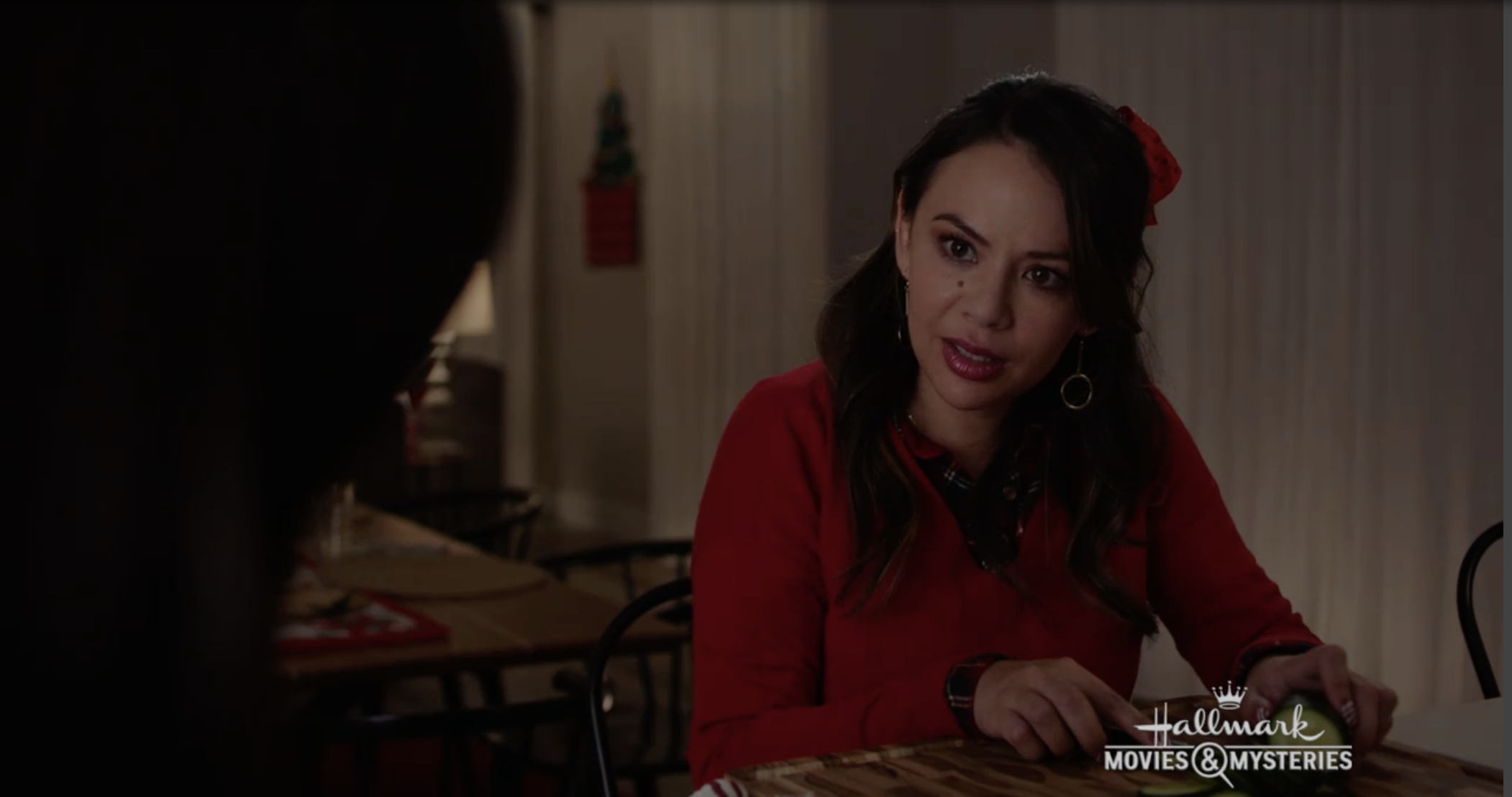 Janel Parrish wearing a holiday sweater