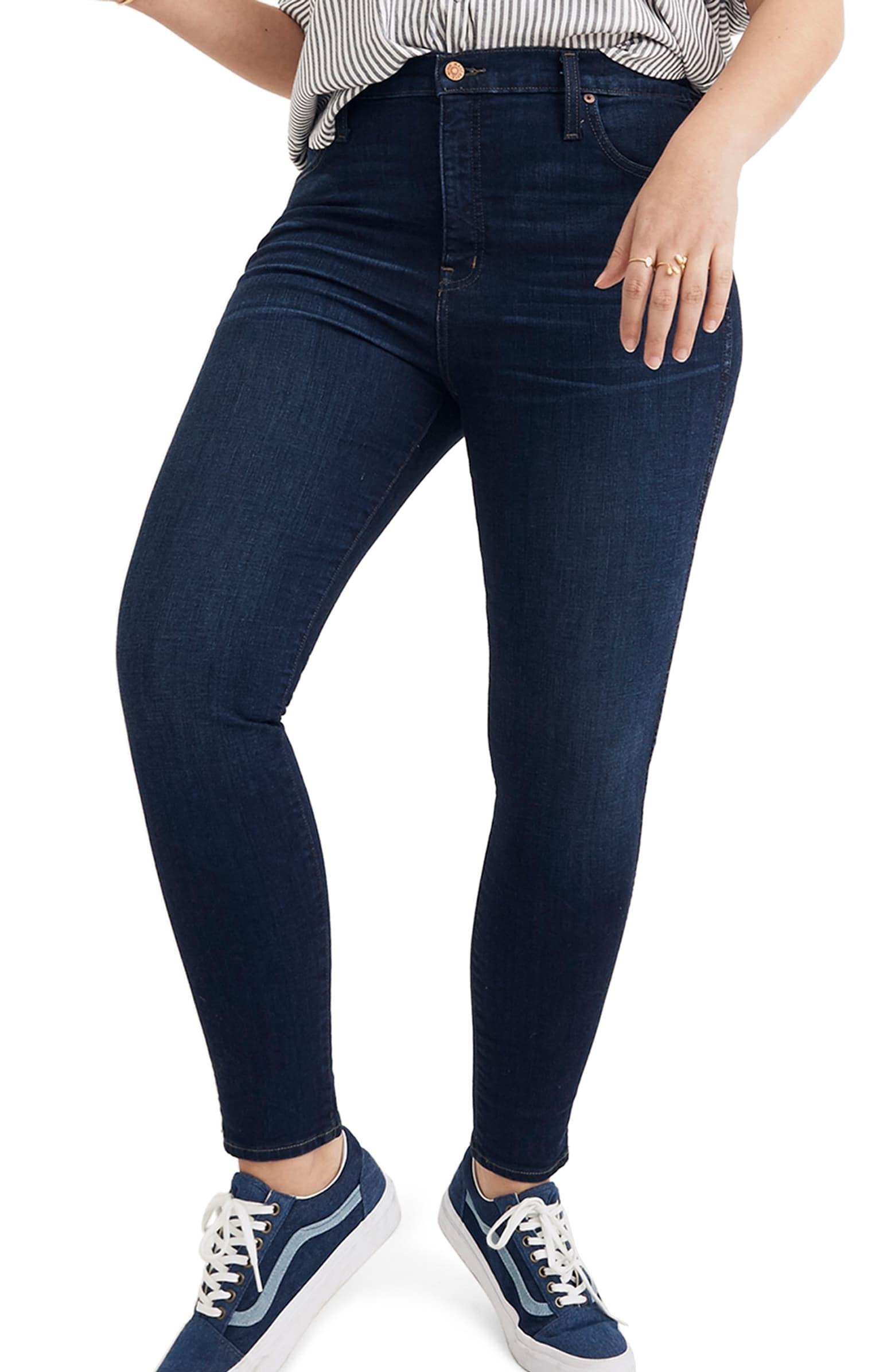 Plus-size model wearing the dark blue jeans