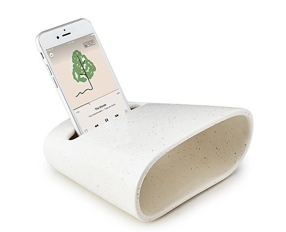 A ceramic phone amplifier with a minimalist speckled white design