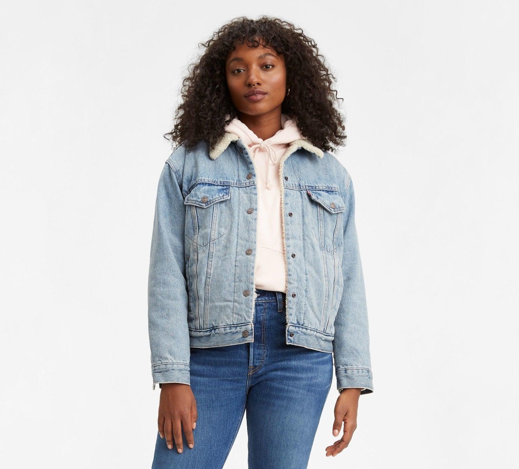 Model wearing the jacket in a light-wash denim