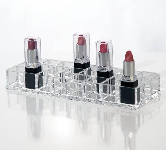 An organiser with 4 lipsticks in cubes
