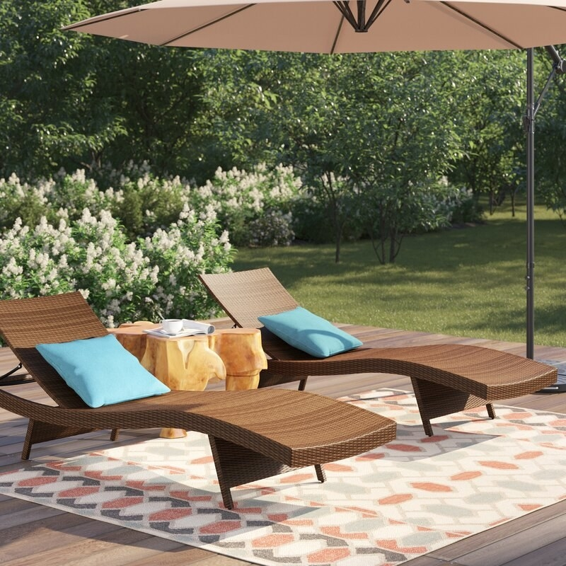 The woven wicker loungers in tan