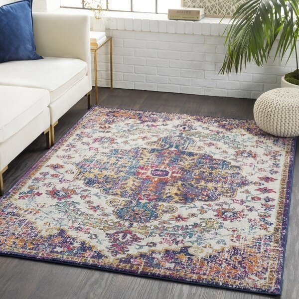 Purple and gold Turkish rug with faded tan details