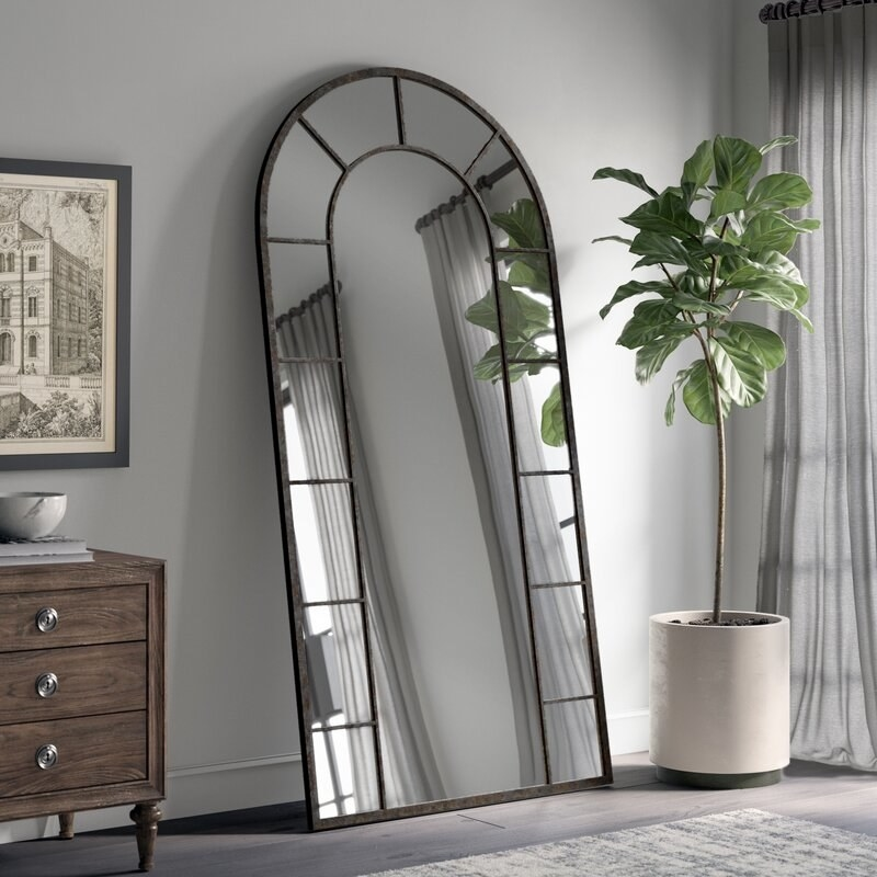 The arched metal mirror