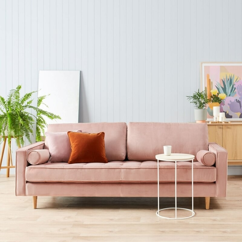 The square arm sofa with matching square throw pillows