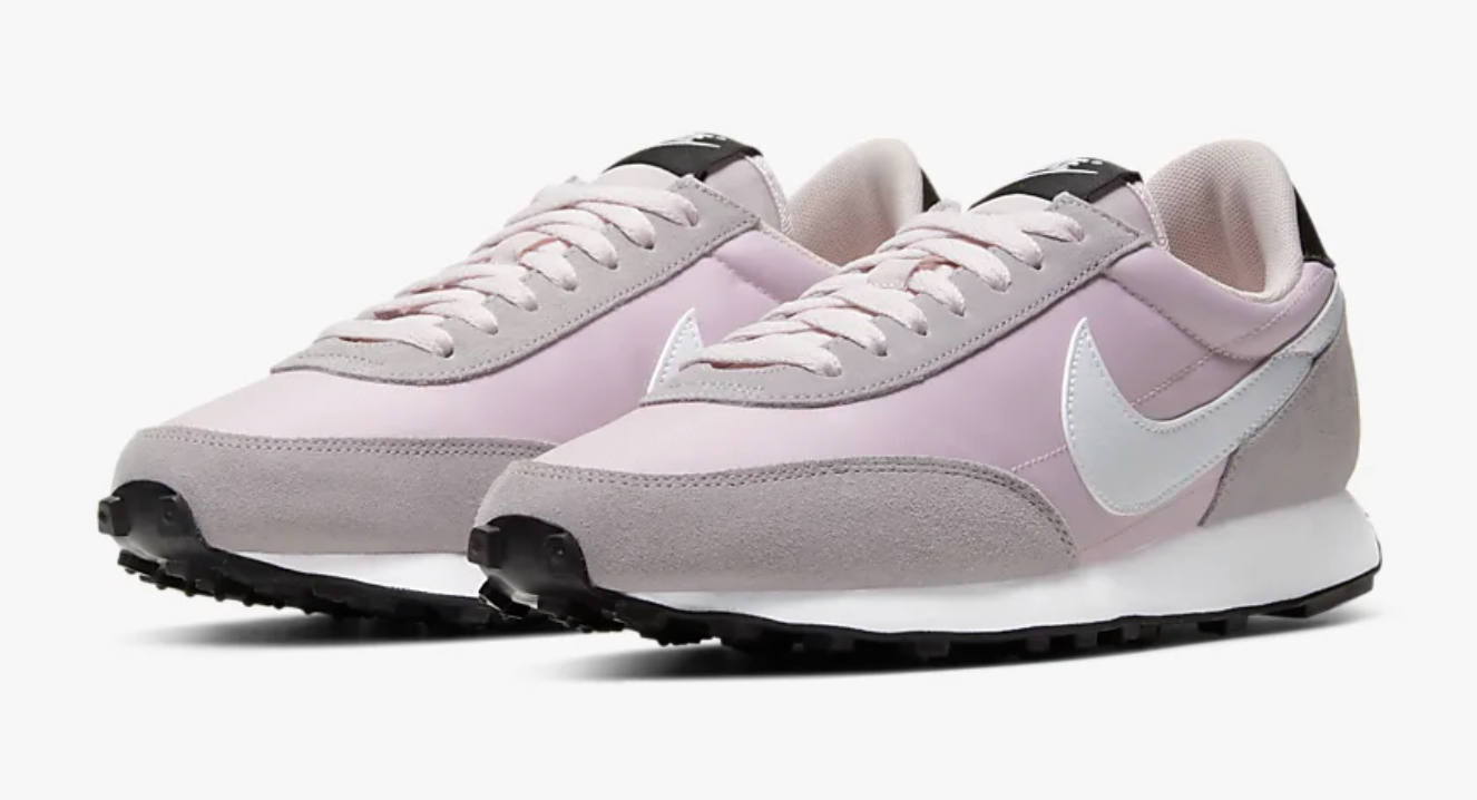 The sneakers in lavender with light pink laces and white, black, and silver details