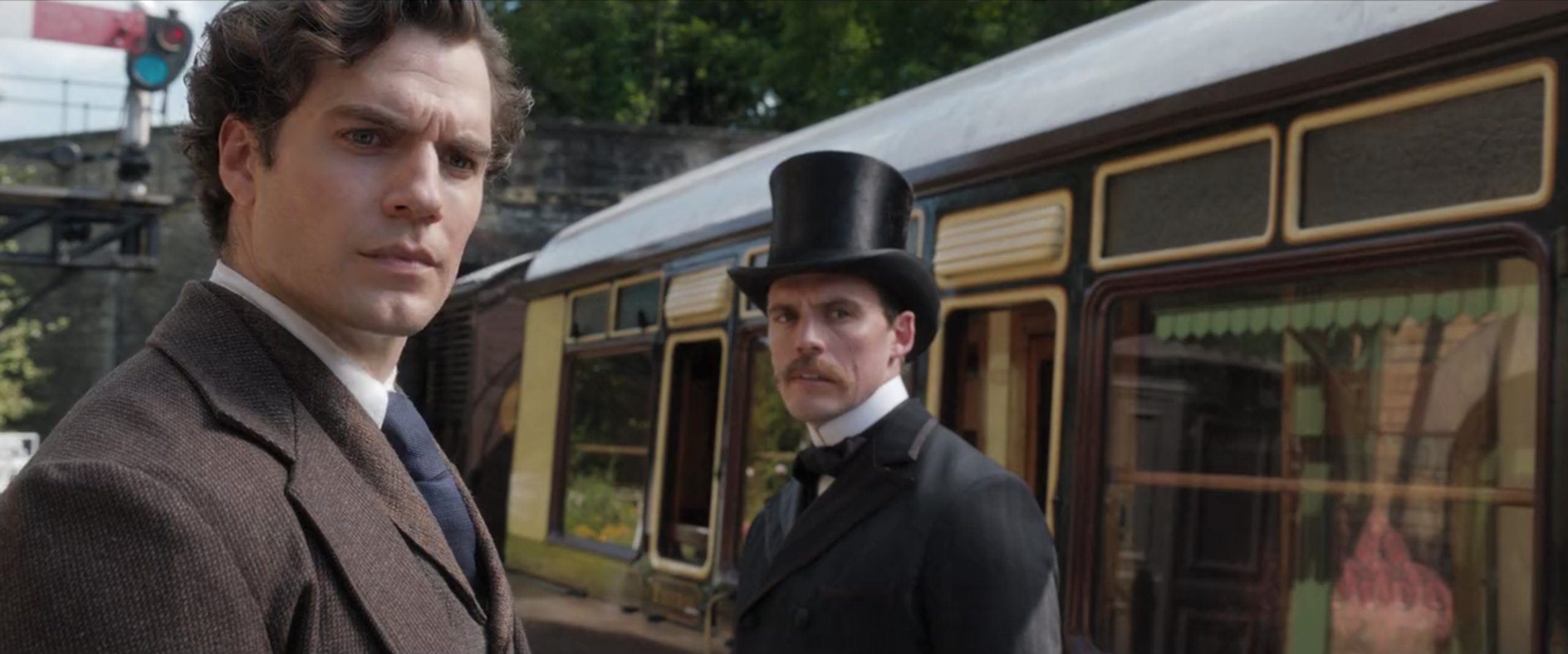 Sherlock and Mycroft stare at Enola, who is out of the frame.