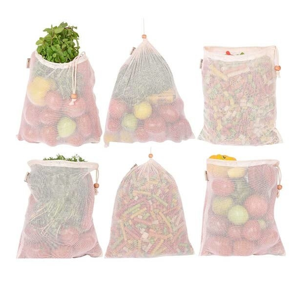 Six mesh bags pictured with vegetables inside them.