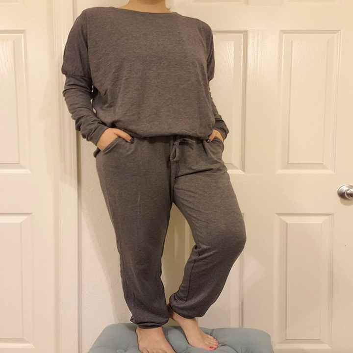 reviewer wearing gray sweatpants with matching gray crewneck sweater