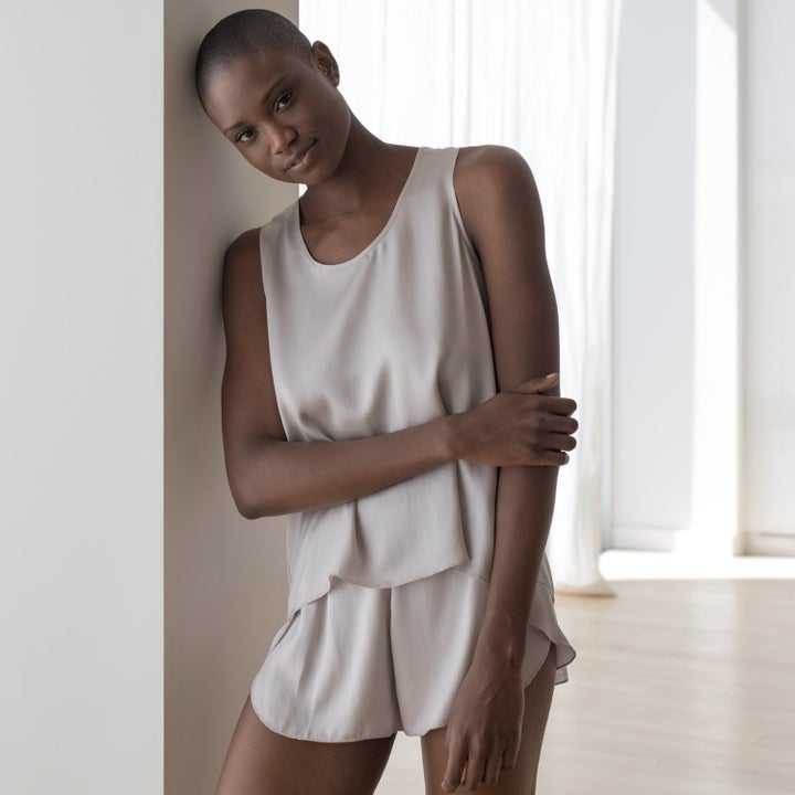 model wearing cloud-colored tank top and shorts
