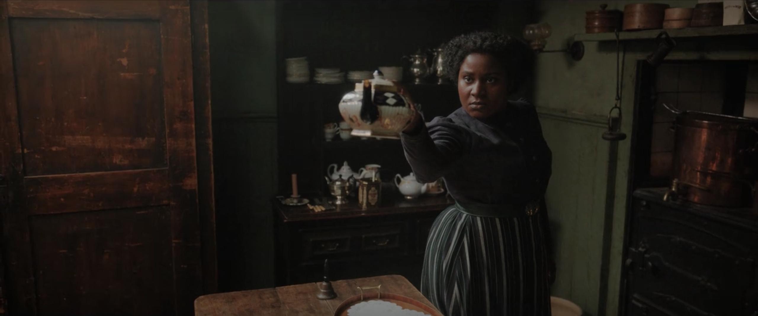 Edith pointing a teapot menacingly at an off-screen Sherlock.