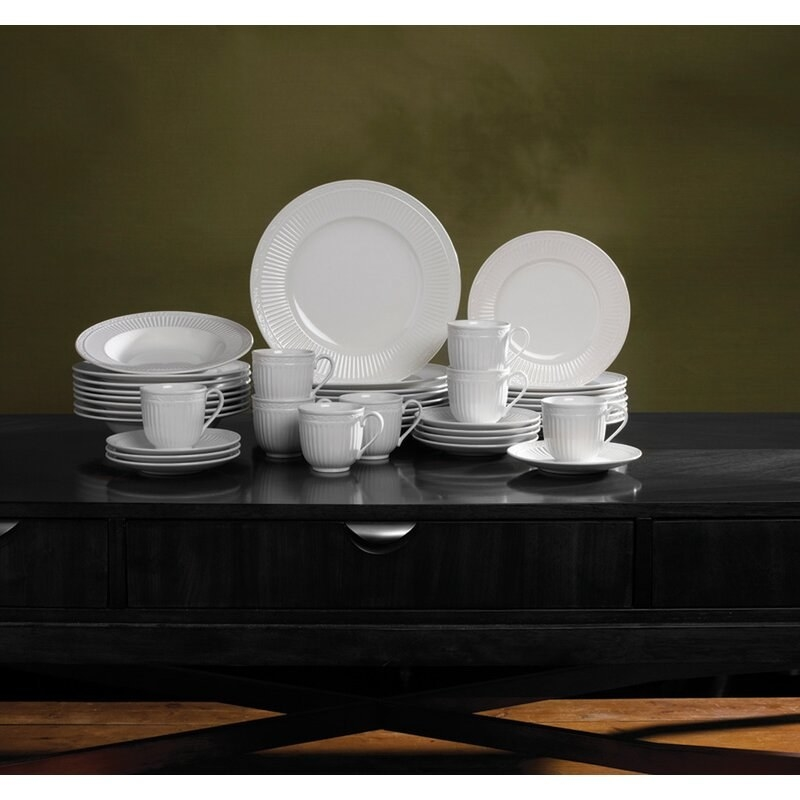 The white plates, bowls, and bugs with a fluted edge