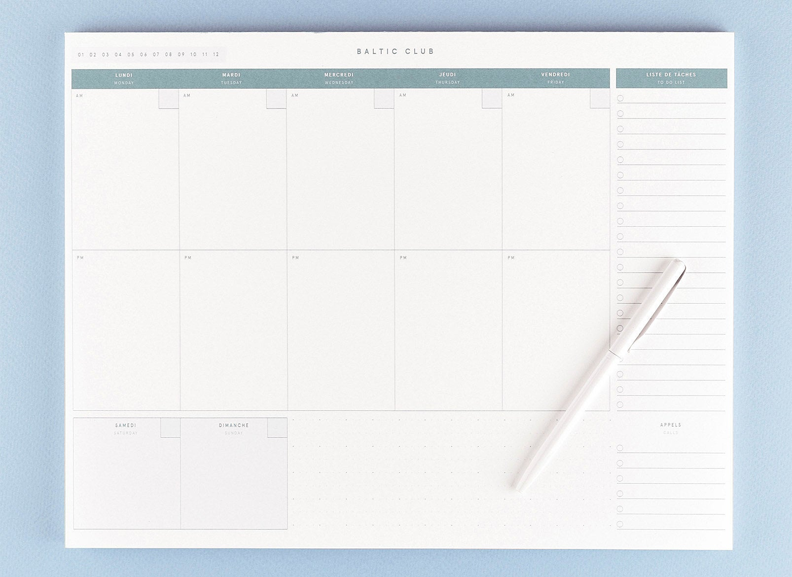 A weekly planner on a large pad of paper There are sections for each day of week with a column on the side with a checklist