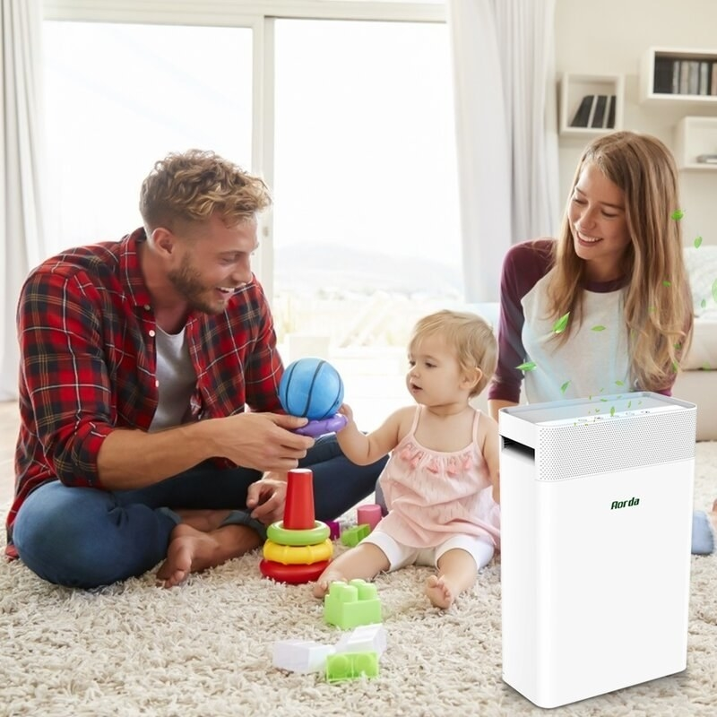 white air purifier in living room