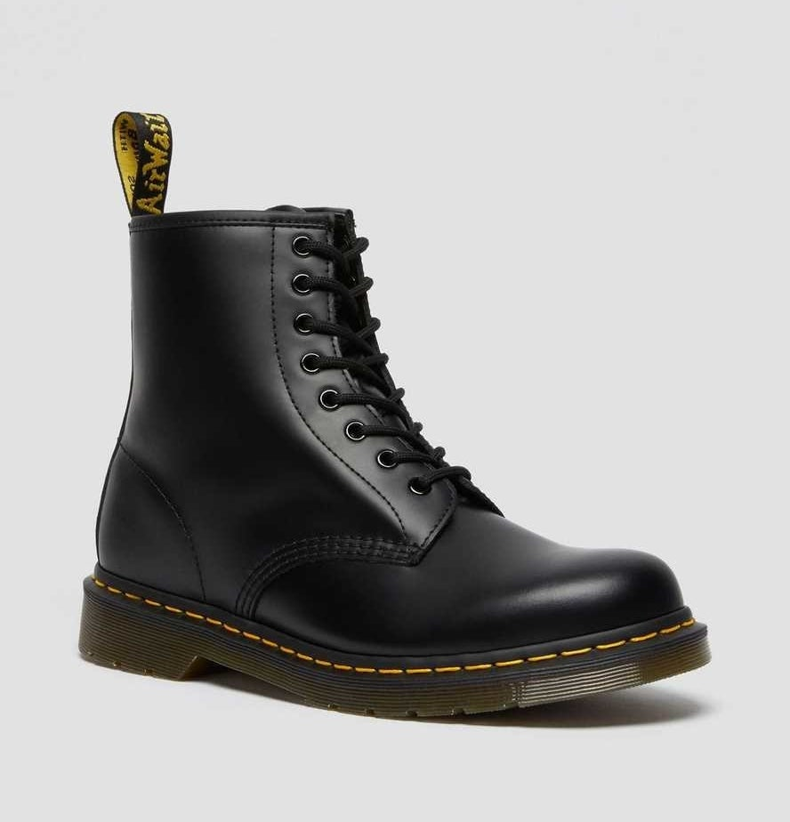 The high-top leather boots in black with black laces, yellow stitching, and a slight heel