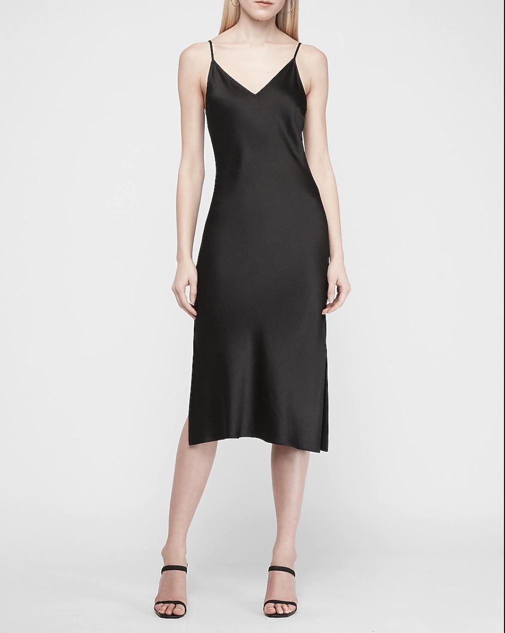 Model in a black midi tank V-neck satin dress
