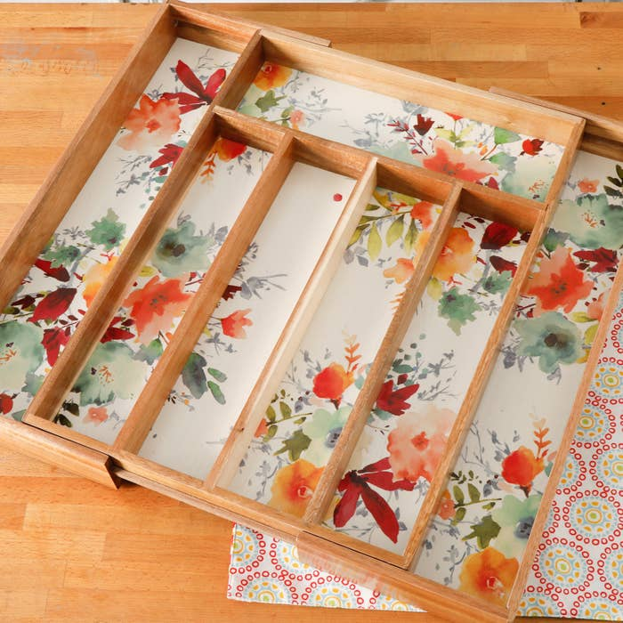 The tray expanded to show the floral liner and additional compartments.