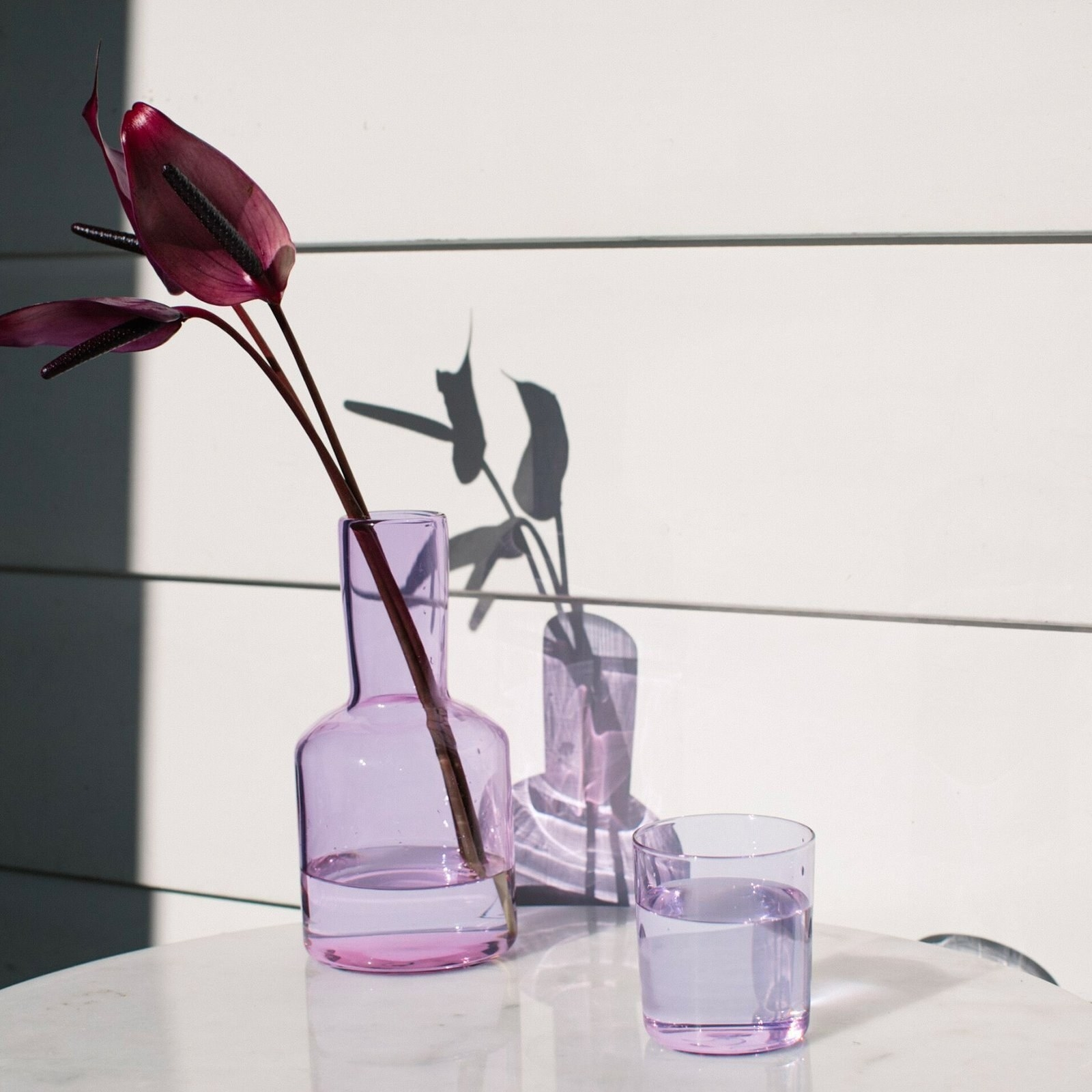 Carafe and matching tumbler filled with water